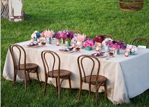 pink-and-purple-flower-arrangemnts-party-wedding-table