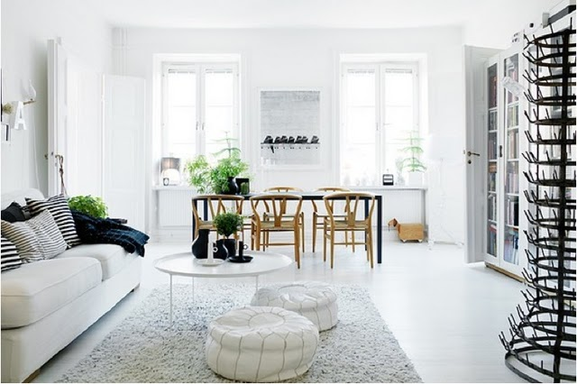white-bright-living-room-white-floors-couch-black-accents