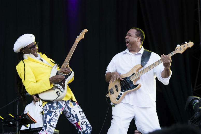 Nile Rodgers (left) and Chic perform on stage during the Isle of Wight festival at Seaclose Park, Newport.