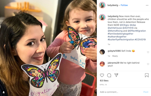 An Instagram post of a woman and child holding paper butterflies.