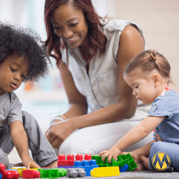 Woman and children playing with toys