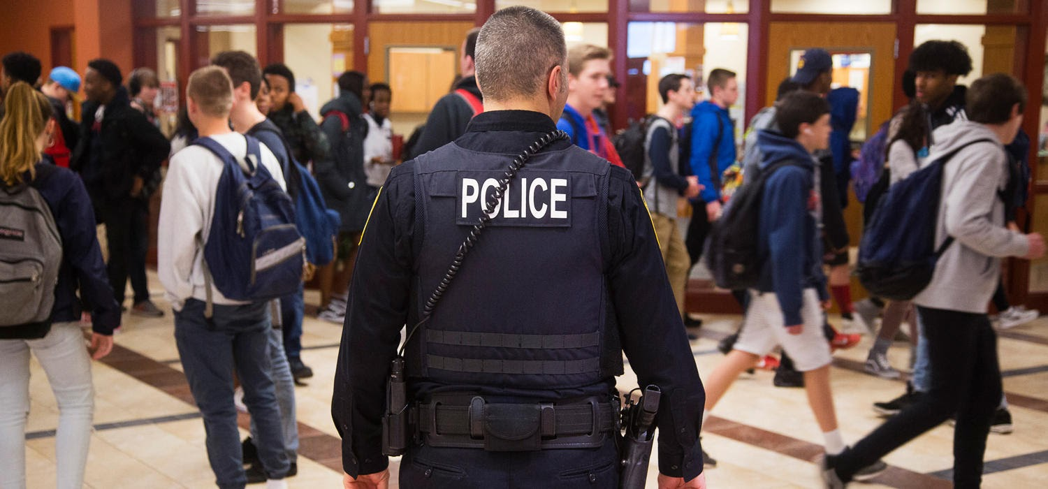 Police officer in a school hallway