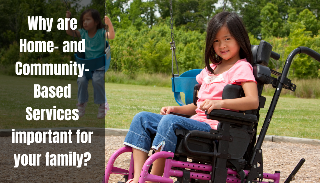 A girl with black hair sits in her wheelchair on a playground