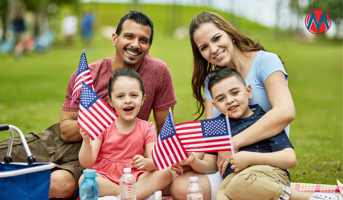 Latinx-American family holding flags