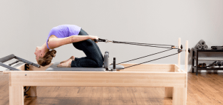 Woman working out on a Studio Reformer