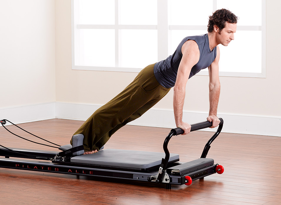 Man standing on Allegro Stretch Reformer