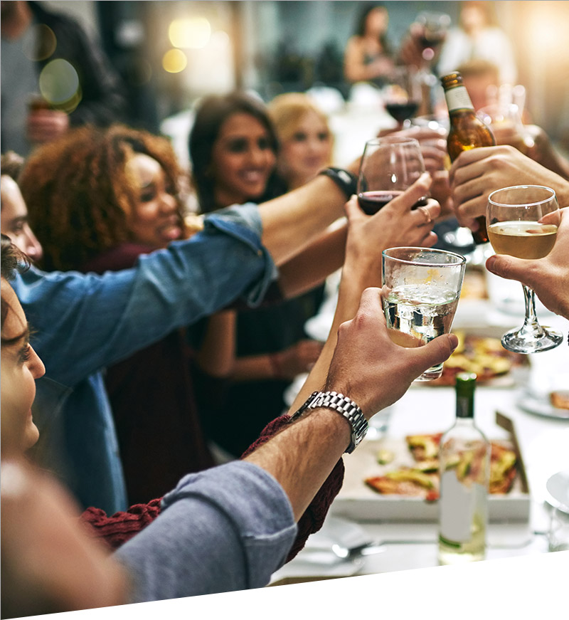 People toasting each other at a long table
