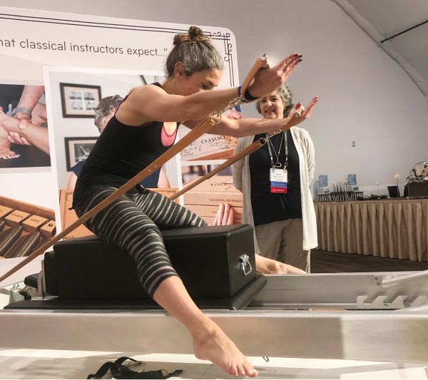 Woman working out on Contrology Reformer at PMA