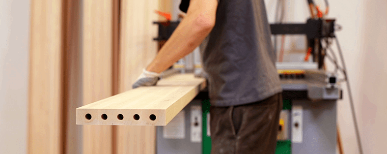 Woodworker building a Reformer