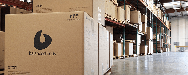 Photo of boxes stacked in warehouse inventory