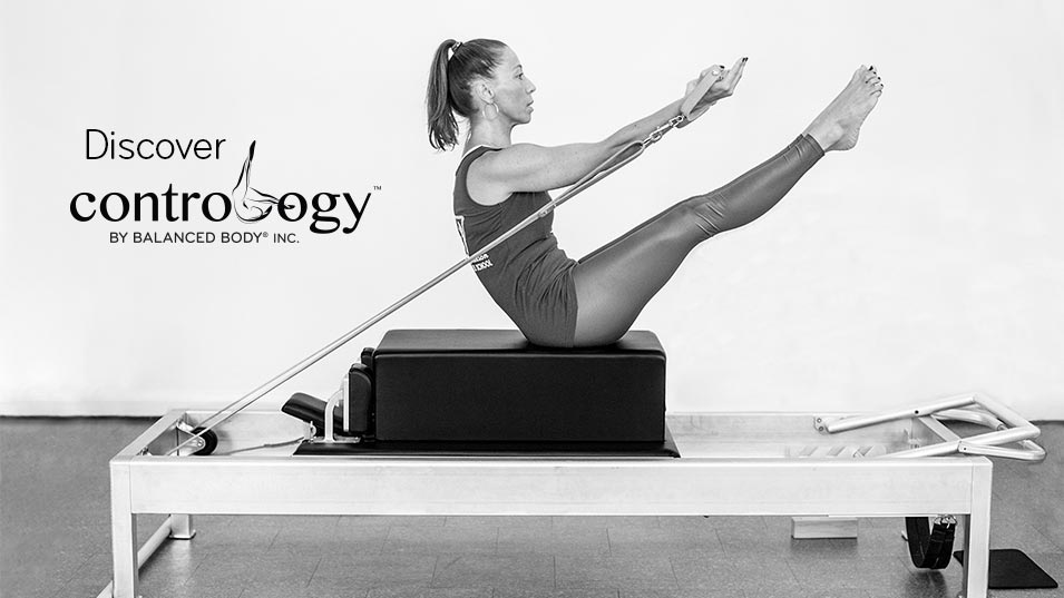 Discover Contrology. Black and white photo of a woman on a Contrology Reformer
