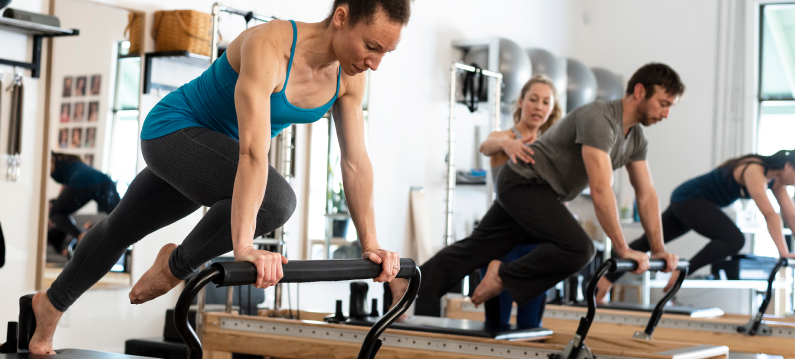 Group Allegro Reformer workout with handles