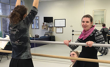 Photo of women working with Barre