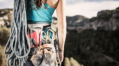 Photo of woman wearing climbing gear
