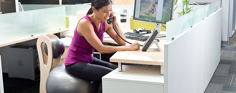 Woman sitting on Begin Chair at an office desk