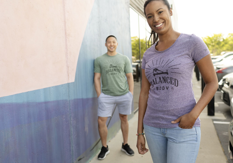 Photo of man and woman wearing Balanced body tee-shirts