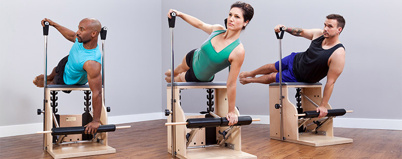Three people working out on Combo Chairs