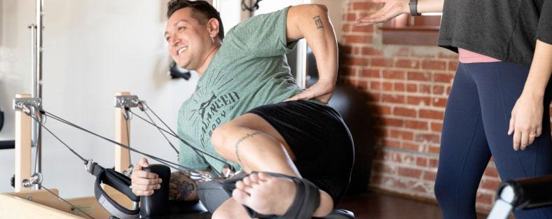 Close up photo of man using Konnector ropes