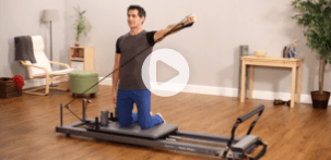 Man working out on an Allegro Reformer