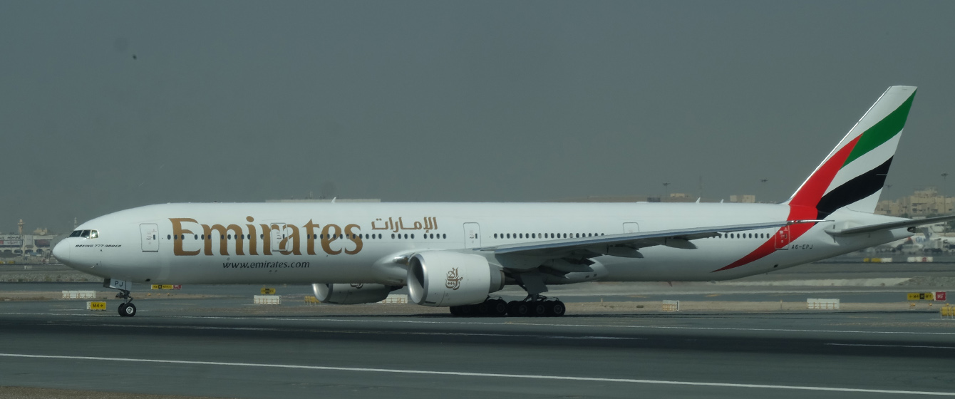 Emirates B777-300ER going to position.