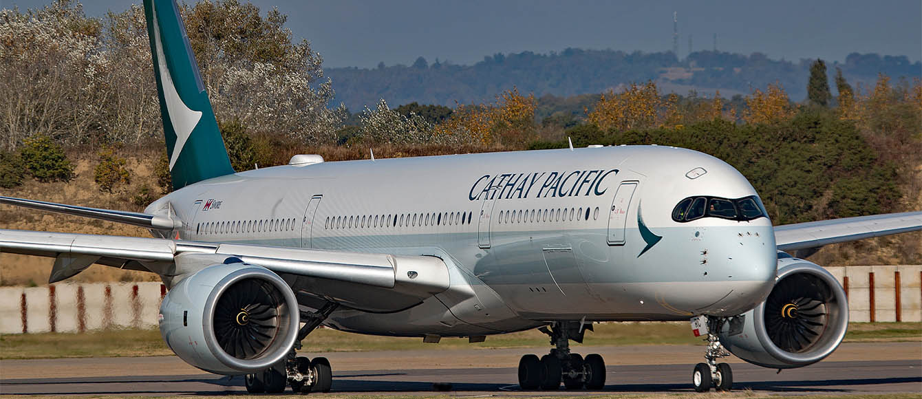 Cathay Pacific's latest Airbus A350 taxiing into stand.  Hiring Pilots.