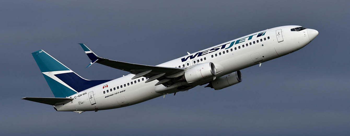 WestJet Boeing B737-800NG on the way up to FL330.
