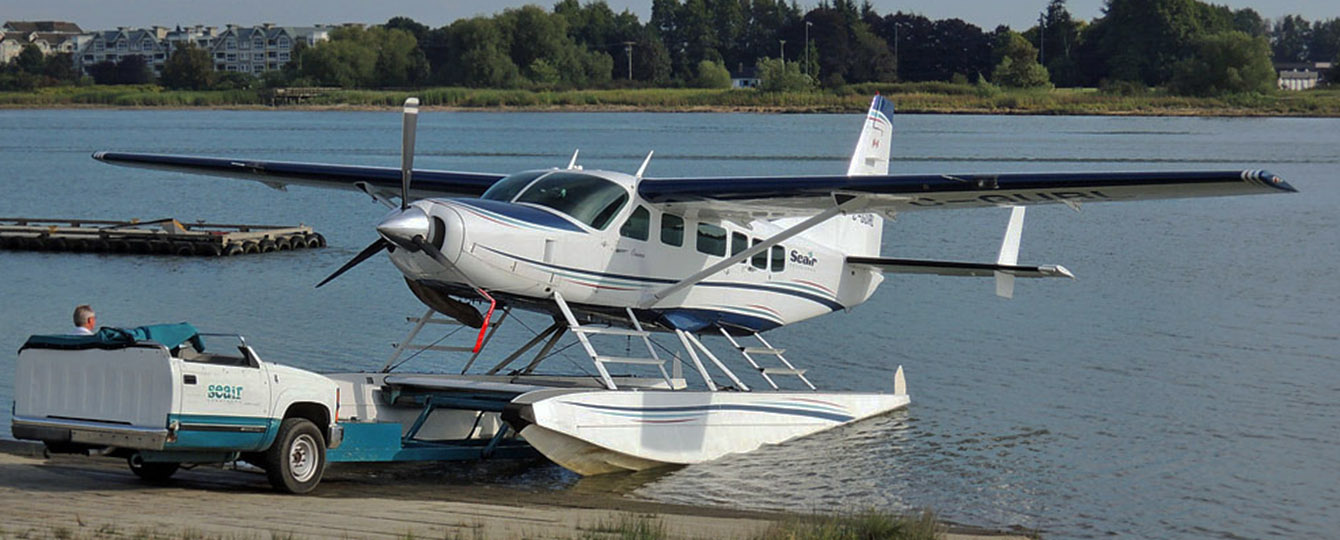 Cessna Caravan Seaplane being pulled in for cleaning.