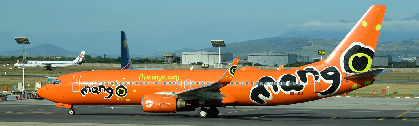 Mango Boeing 737-800 headed out for take off.
