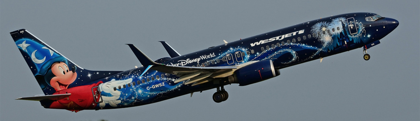 WestJet 737-800NG Disney on initial climb out.