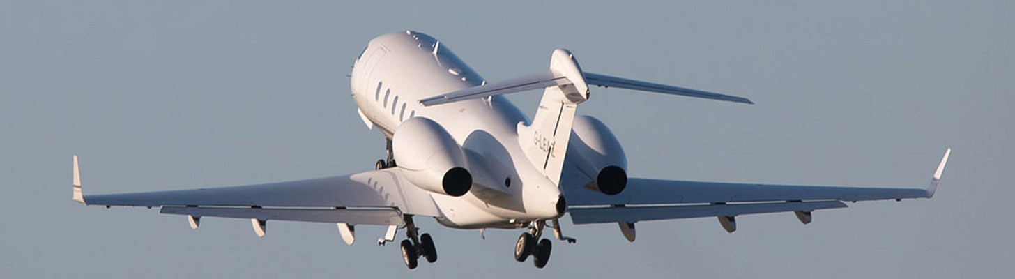 Challenger 300 on initial climbout