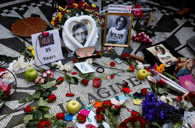 Photos and flowers are placed in Central Park's Strawberry Field to commemorate John Lennon's death
