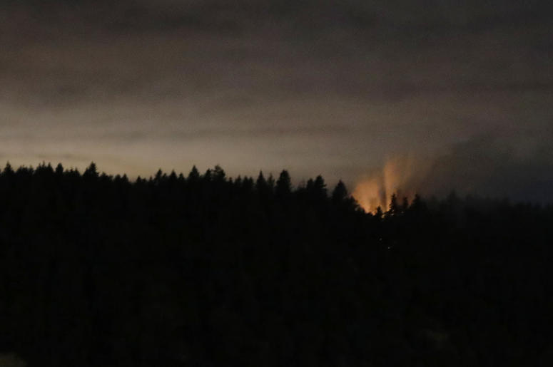 In This Long Exposure Photo Smoke And An Orange Glow Are Seen On Ketron Island Washington State Early Saturday Aug 11 2018 As Viewed From Near