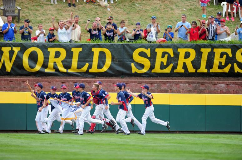 Mid-Atlantic Region players celebrate after beating the Asia-Pacific Region 2-1 during the championship game of the 2016 Little League World Series at Howard J. Lamade Stadium.