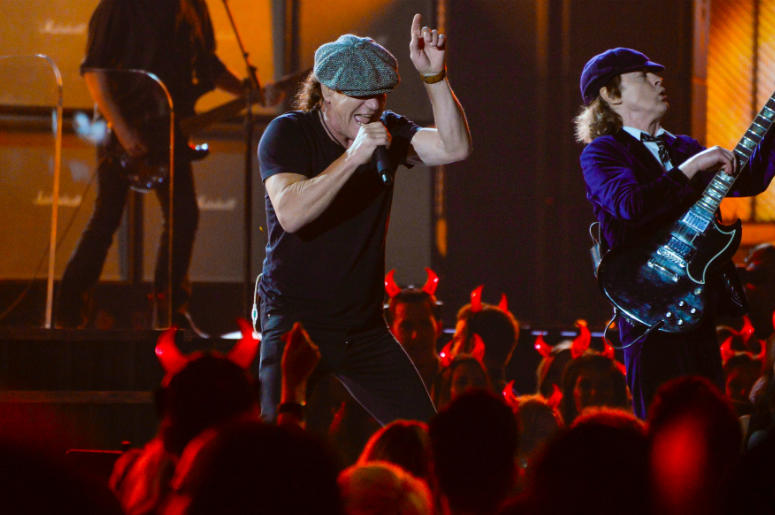 "AC/DC lead vocalist Brian Johnson (left) and guitarist Angus Young performs ""Rock or Bust\"" and \""Highway to Hell\"" at the 57th annual Grammy Awards at the Nokia Theatre."