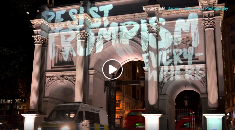 video still image of marble arch with the words resist trumpism everywhere with link to the video