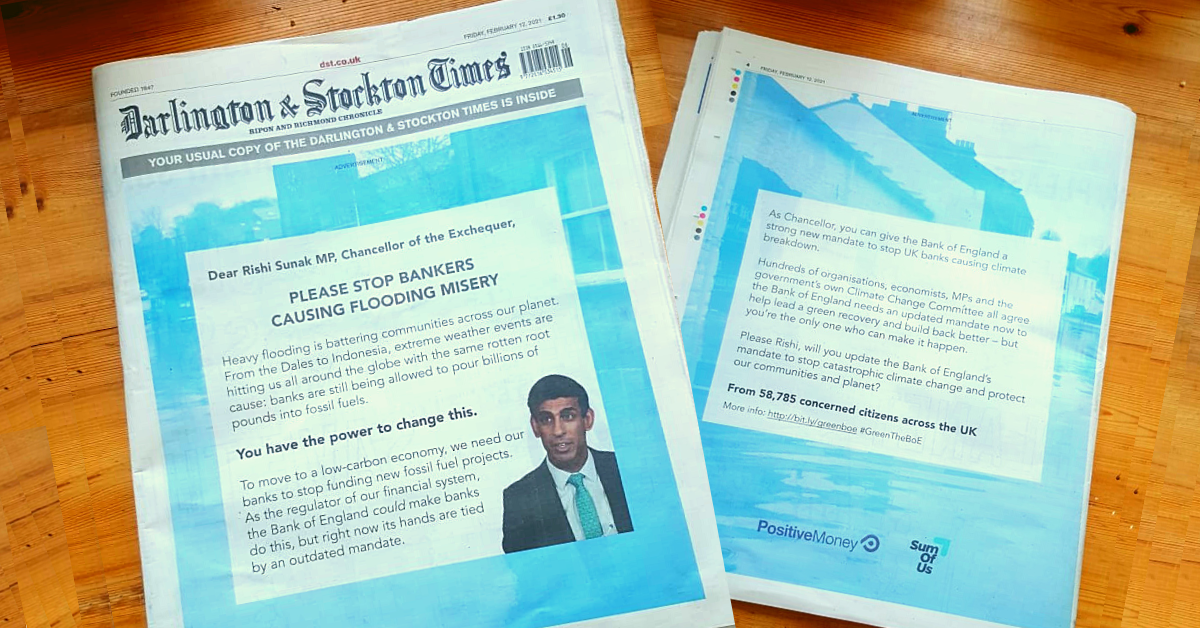 A newspaper laid out on a table showing the four page ad delivering SumOfUs members' petition in the UK Chancellor of the Exchequer's local paper