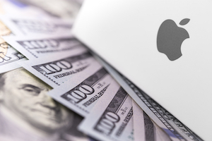 The Apple logo surrounded by cash