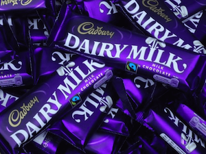 dairy milk chocolate bars in a pile