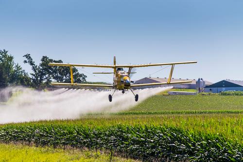 Plane spraying pesticide