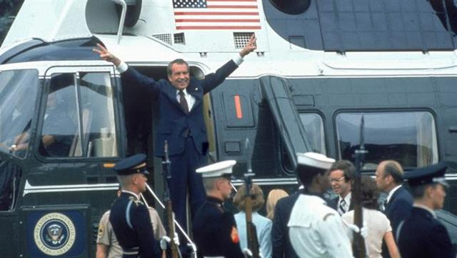 Richard Nixon resigns due to the Watergate scandal.