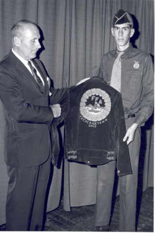 Blue corduroy jacket adopted as Official Dress.
