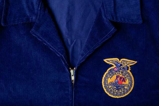 Blue corduroy jacket. FFA officers greeted by president