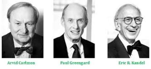 Arvid Carlsson (Suecia, 1923-), Paul Greengard (E.EU.U., 1925-) y Eric R. Kandel (E.E.U.U., 1929-)