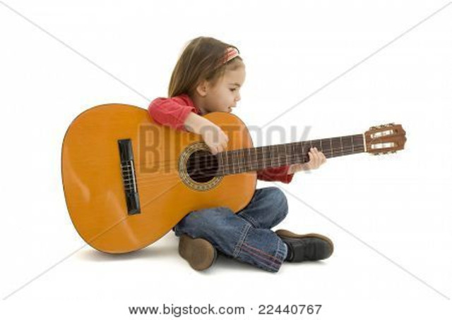 Beth playing guitar.