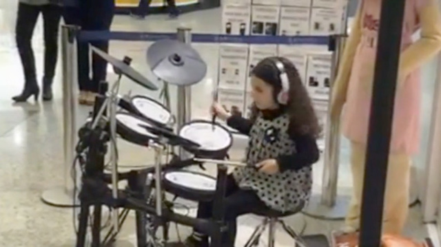 Txell playing drums