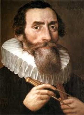 Johannes Kepler published the first two laws of planetary motion.