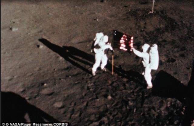 Neil Armstrong/Buzz Aldrin walk on the moon
