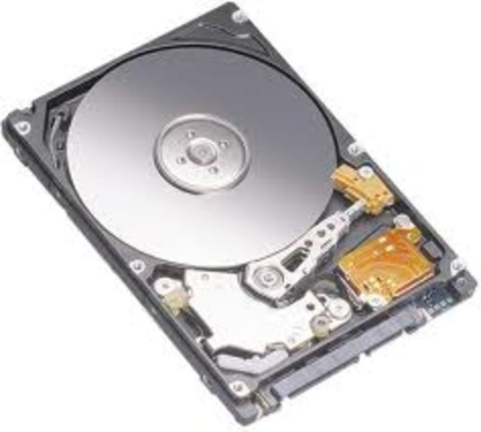 First disk drive for random-access storage of data