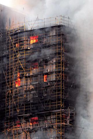 49 killed in Shanghai as fire engulfs high-rise