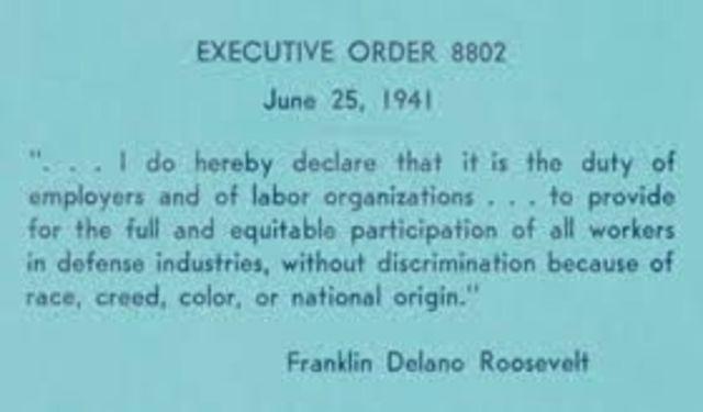 President Franklin D. Roosevelt signs Executive Order 8802 (U.S. 1)